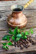 Turk and coffee beans Stock Photos