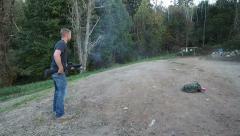 Man firing shotgun from hip Stock Footage