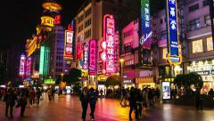 Night hyperlapse of Nanjing Road with people and colourful signboards. Shanghai Stock Footage