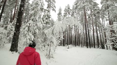 Happy mother and baby girl having fun on the walk in winter snowy forest Stock Footage