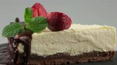 Slice of chocolate cheesecake Stock Footage