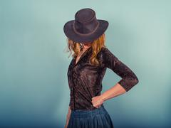 Young woman wearing a cowboy hat Stock Photos