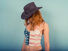 American woman with cowboy hat - stock photo