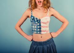 Young woman wearing stars and stripes - stock photo