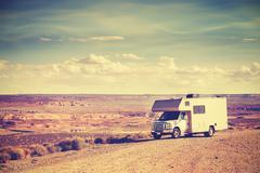 Retro toned camper parked by canyon, vacation concept. Stock Photos