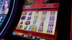 Close up woman playing slot machine inside Hard Rock Casino - stock footage