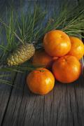 Juicy oranges on the old wooden table Stock Photos