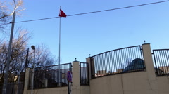 Waving Turkish Flag at The Turkish Embassy Fence City Street Cityscape Road Stock Footage