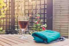 Glass of beer and apron on table Stock Photos