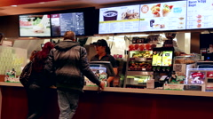 People ordering food at mcdonalds check out counter in Coquitlam BC Canada Stock Footage