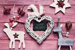 christmas ornaments and text happy holidays, filtered - stock photo