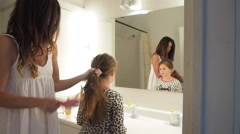 Stock Video Footage of Mother Combing  Daughters Hair