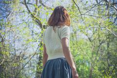 Young woman exploring a forest - stock photo