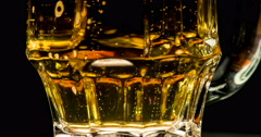 Faceted Glass with Beer 4K Stock Footage