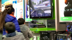 Best buy's black friday sale with shopper playing new Xbox game - stock footage