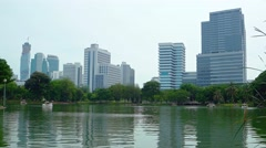 Urban Lake Park under Highrise Buildings of a Major City Stock Footage