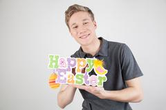 man holding a poster celebrating easter - stock photo