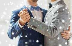 close up of happy male gay couple dancing - stock photo