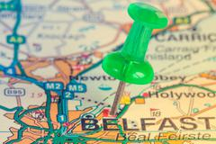 Green pushpin showing Belfast location - stock photo