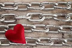 Stock Photo of Four chains with red heart