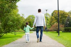 Happy family walking in summer park Stock Photos