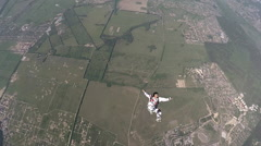Skydiver in accelerated free fall course Stock Footage