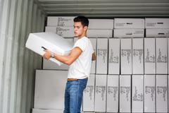 Young Man with Large White Box by Freight Train Stock Photos