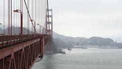 Golden Gate Bridge with Pedestrian and vehicular traffic on a foggy day Stock Footage