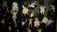 Haunted House Scary horror asylum dolls on fence 2 Stock Footage