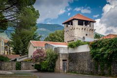 Ancient fortress watch tower in the Tivat old district Stock Photos