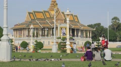 People and pidgeons in royal palace park,Phnom Penh,Cambodia Stock Footage