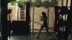 The woman practices boxing Stock Footage