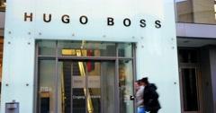Unidentified People Walk Near Hugo Boss Shop 4k Stock Footage