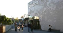 Unidentified People Walk Near Gucci Shop 4k Stock Footage