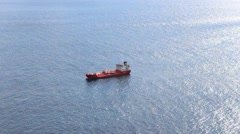 Red ship alone on ocean - lonely tanker in water Arkistovideo