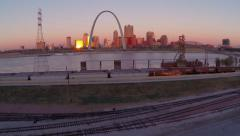 Saint Louis Arch aerial fly up from across the Mississippi at sunrise Arkistovideo