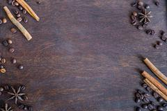 Stock Photo of Coffee beans, cinnamon and anise stars on dark wooden backround