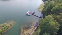 Span through pine trees on a drone to expensive yachts - stock footage