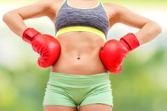 Fitness Slim Sporty Woman Body ,with boxing gloves, athletic women showing he - stock photo