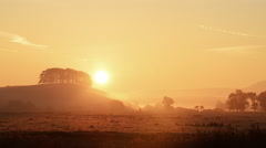 Sunrise in a foggy valley Stock Footage