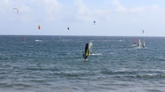 windsurfer,  kitesurfer surfing at beach Stock Footage
