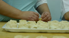 Rolling dough and making dumplings Stock Footage