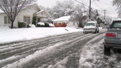 Car driving on snow covered road - stock footage