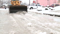 Snow plow clearing snow - stock footage