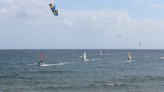 "Many kitesurfer and windsurfer  surfing at ""El Medano"", tenerife - Surfer beach Stock Footage"