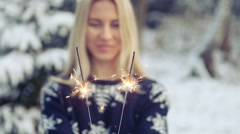 Woman walking in winter forest Christmas and lights sparkler - stock footage