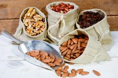 assortment of dried fruit in small bags canvas - stock photo