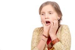 Little girl with a toothache isolated on the white background Stock Photos