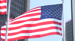 American flag outside of General Motors building Stock Footage