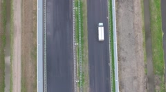Aerials truck driving on new highway shot from above - stock footage